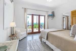 Bay-facing bedroom in Dogwood Suite at Jubilee Suites in Fairhope, AL