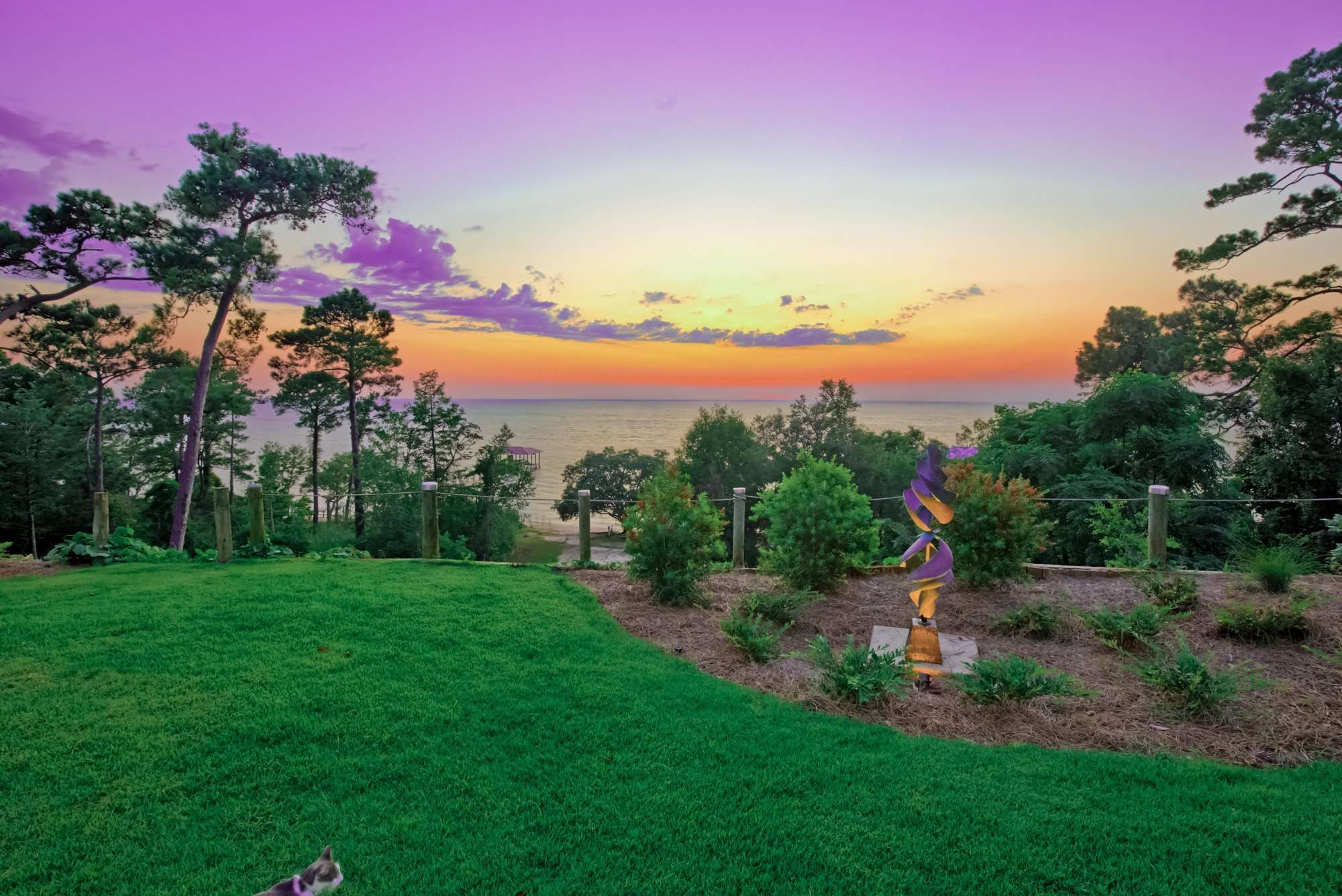 Jubilee Suites in Fairhope, AL Sunset with Sculpture