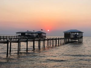 View of sunset and pier at Jubilee Suites in Fairhope, AL