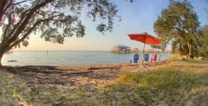 Beach with umbrella at Jubilee Suites in Fairhope, AL
