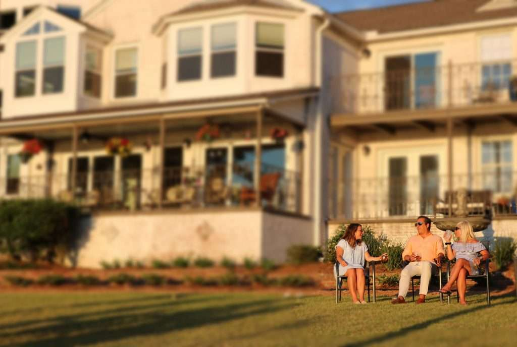 Family at sunset at Jubilee Suites in Fairhope, AL